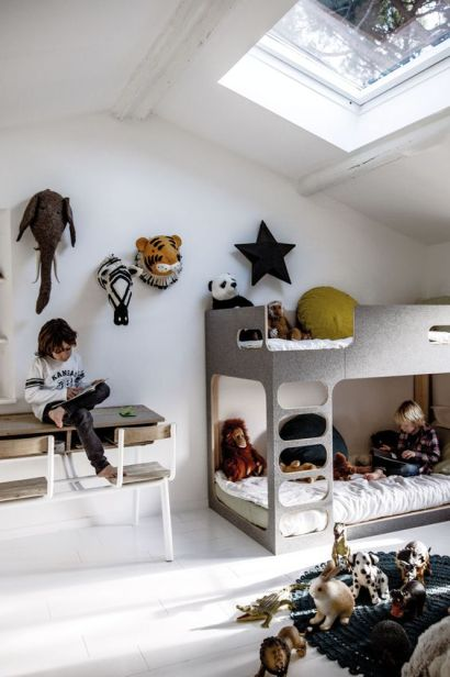 I love how the white walls work so well with the mixed animal heads and pops of earthy colour on the bed. Amazing bunk bed too! Photo: Pinterest